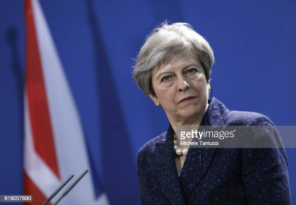 British Prime Minister Theresa May speak to the media following talks between the two leaders at the Chancellery on February 16 2018 in Berlin...