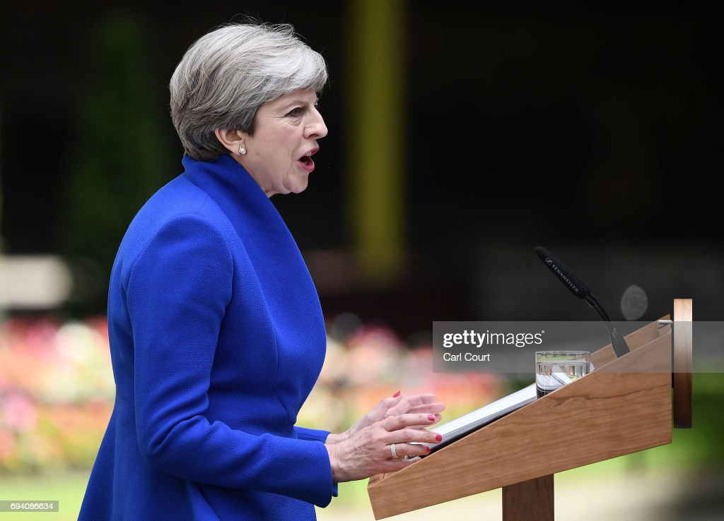 British Prime Minister Theresa May speaks after returning from Buckingham Palace outside 10 Downing Street on June 9, 2017 in London, United Kingdom. After a snap election was called by Prime Minister Theresa May the United Kingdom went to the polls yesterday. The closely fought election has failed to return a clear overall majority winner and a hung parliament has been declared.