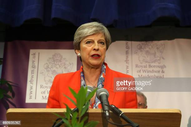 British Prime Minister Theresa May speaks after winning her seat at the count centre in Maidenhead early in the morning of June 9 hours after the...