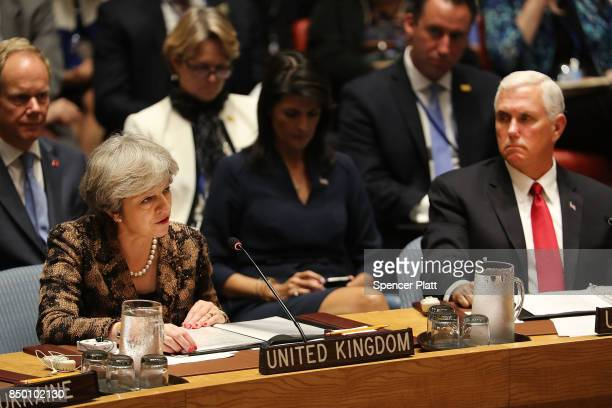 British Prime Minister Theresa May speaks at a Security Council meeting as US Vice President Mike Pence during the 72nd United Nations General...