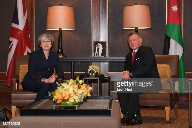British Prime Minister Theresa May speaks during a bilateral meeting with King Abdullah II of Jordan at the Royal Palace on November 30 2017 in Amman...