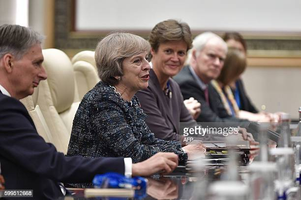 British Prime Minister Theresa May speaks during a meeting with Chinese President Xi Jinping at the West Lake State House in Hangzhou on September 5,...