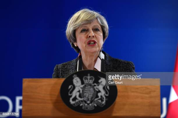 British Prime Minister Theresa May speaks during a press conference at the Council of the European Union on the first day of an EU summit on March 9...