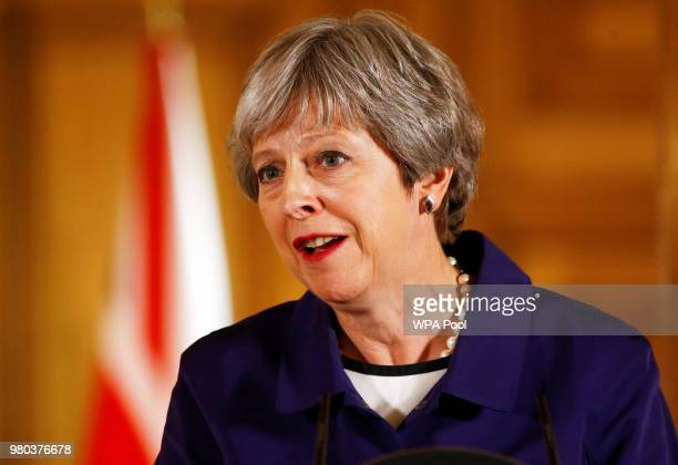 British Prime Minister Theresa May speaks during a press conference with Secretary General of NATO Jens Stoltenberg inside Number 10 Downing Street...