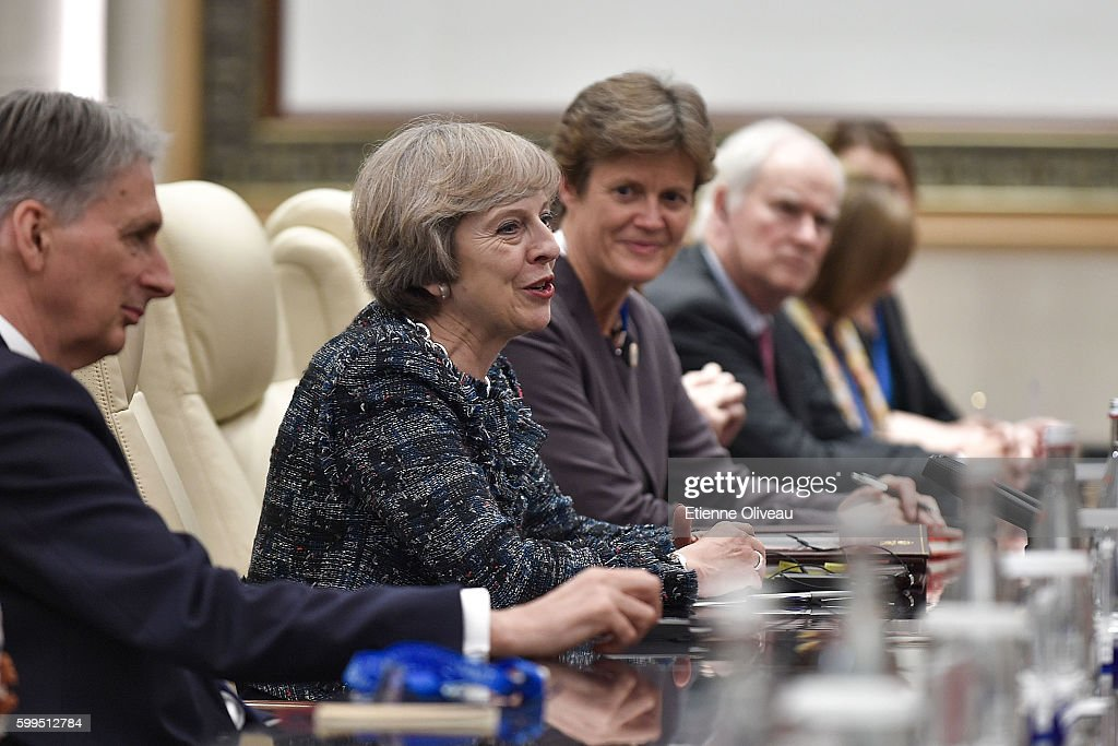 British Prime Minister Theresa May (2nd-L) speaks during his meeting with Chinese President Xi Jinping (not pictured) at the West Lake State House on September 5, 2016 in Hangzhou, China. World leaders have gathered in Hangzhou for the 11th G20 Leaders Summit from September 4 to 5.