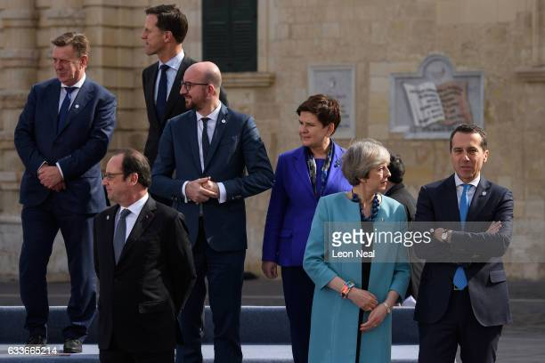 British Prime Minister Theresa May speaks to the Federal Chancellor of Austria Joseph Muscat ahead of the family photo at the EU Informal Summit on...