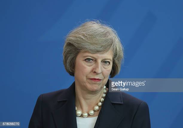 British Prime Minister Theresa May speaks to the media with German Chancellor Angela Merkel following talks at the Chancellery on July 20 2016 in...