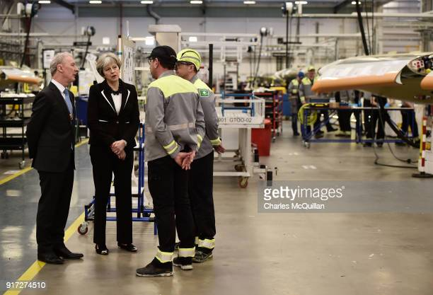British Prime Minister Theresa May speaks to workers accompanied by Michael Ryan president of Bombardier Aerostructures and Engineering services...