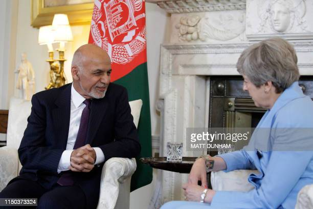 British Prime Minister Theresa May speaks with Afghanistan's President Ashraf Ghani at the start of their meeting inside 10 Downing Street in London...