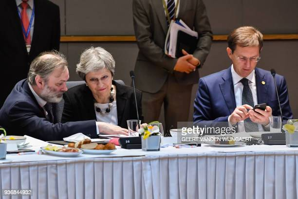 British Prime Minister Theresa May speaks with Britain's Permanent Representative to the European Union Tim Barrow next to Slovenia's Prime minister...