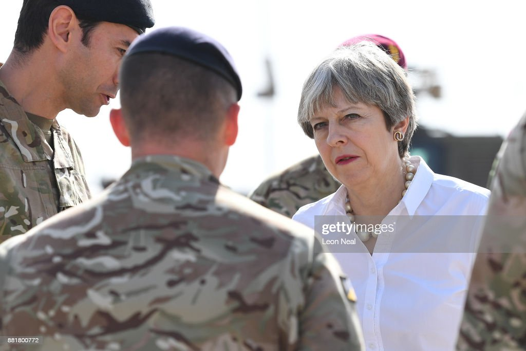 British Prime Minister Theresa May speaks with British soldiers at the Camp Taji military base on November 29, 2017 in Taji, Iraq. Theresa May has made a surprise visit to Iraq during a planned visit to the Middle East.