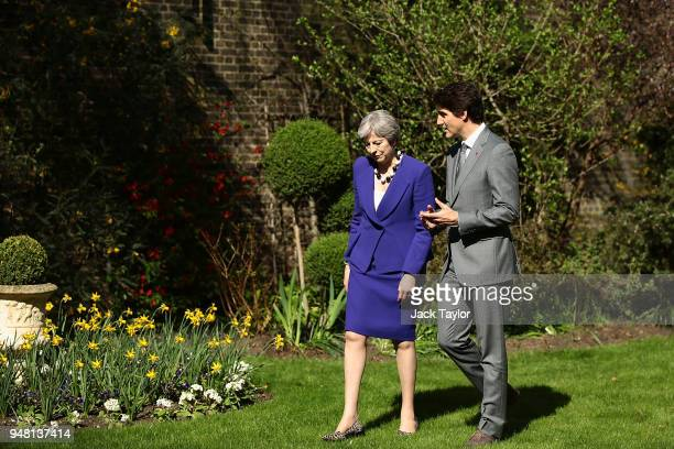 British Prime Minister Theresa May speaks with Canadian Prime Minister Justin Trudeau at Downing Street on April 18 2018 in London England Mrs May...