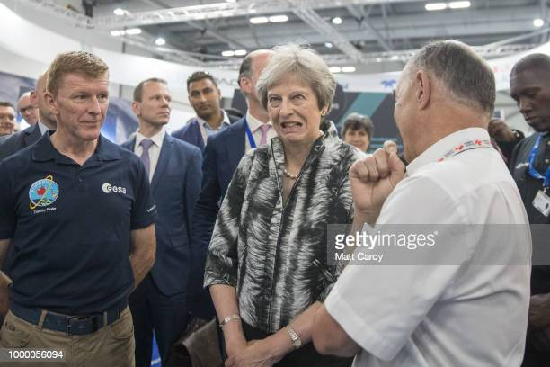 British Prime Minister Theresa May speaks with European Space Agency astronaut Tim Peake as she opens the Farnborough Airshow on July 16 2018 in...