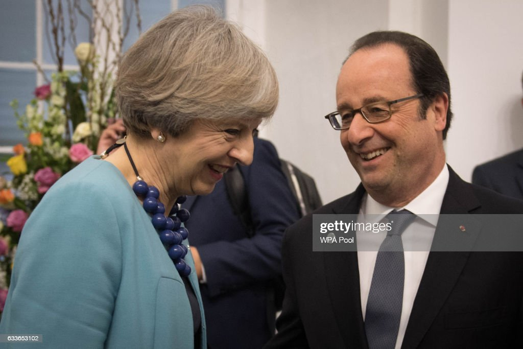 British Prime Minister Theresa May speaks with French President Francois Hollande during the Malta Informal Summit at the Grandmaster's Palace on February 3, 2017 in Valletta, Malta. Theresa May attends an informal summit of the 27 EU leaders to brief them on her recent meeting with President Trump. She has secured a guarantee from Trump that he is 100% supportive of NATO and she will encourage the EU countries to contribute the agreed 2% of their GDP on defence.