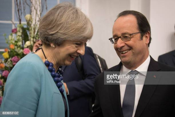 British Prime Minister Theresa May speaks with French President Francois Hollande during the Malta Informal Summit at the Grandmaster's Palace on...