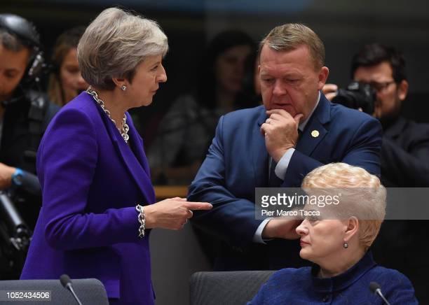 British Prime Minister Theresa May speaks with Lars Lokke Rasmussen Prime Minister of Denmark and President of Lithuania Dalia Grybauskaite during...