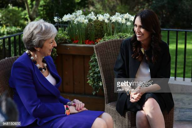 British Prime Minister Theresa May speaks with New Zealand Prime Minister Jacinda Ardern in the gardens at Downing Street on April 18 2018 in London...