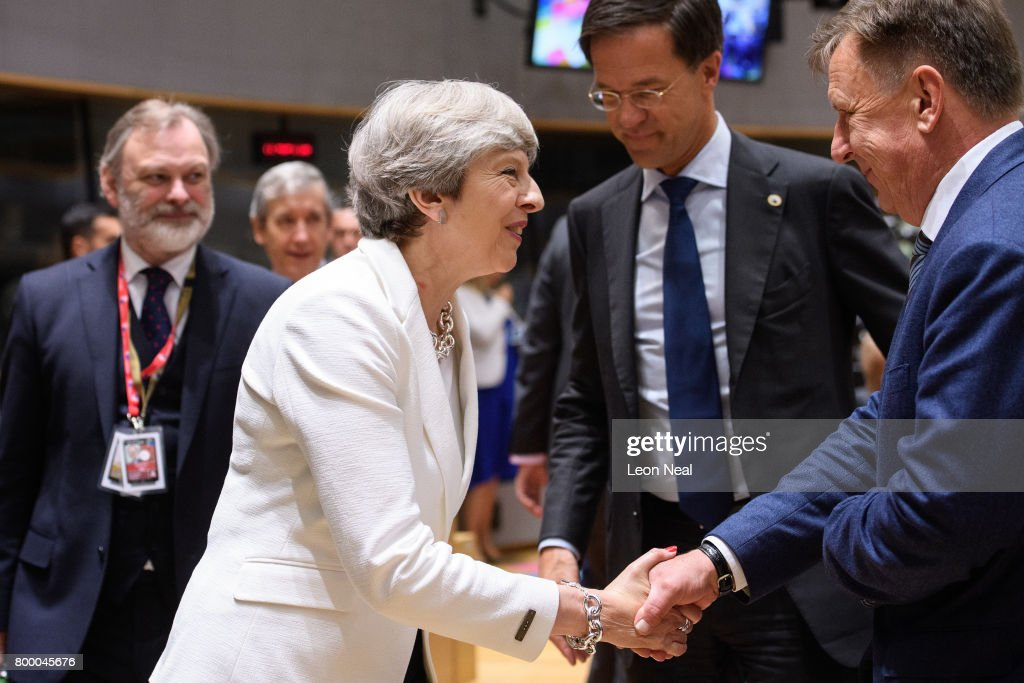 British Prime Minister Theresa May (L) speaks with Romanian Prime Minister Klaus Werner Iohannis (R) ahead of a roundtable meeting at the EU Council headquarters on the second day of a two day European Council summit on June 23, 2017 in Brussels, Belgium.