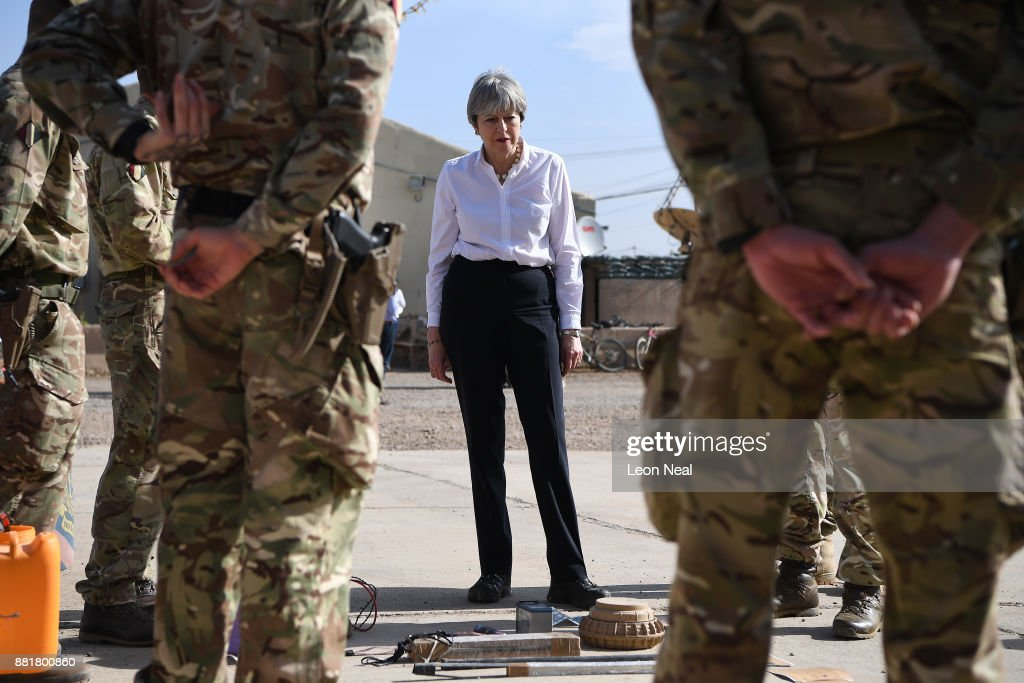 British Prime Minister Theresa May (C) speaks with soldiers at the Camp Taji military base on November 29, 2017 in Taji, Iraq. Theresa May has made a surprise visit to Iraq during a planned visit to the Middle East.