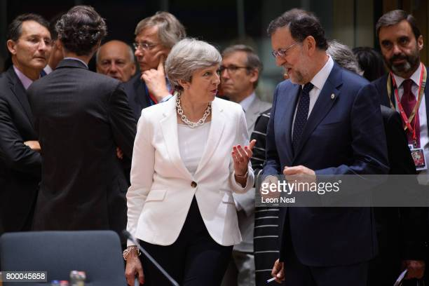British Prime Minister Theresa May speaks with Spain's Prime Minister Mariano Rajoy Brey ahead of a roundtable meeting at the EU Council headquarters...