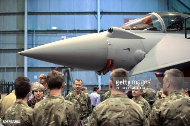 British Prime Minister Theresa May speaks with troops during a visit to wish British servicemen happy holidays at the RAF Akrotiri British military...