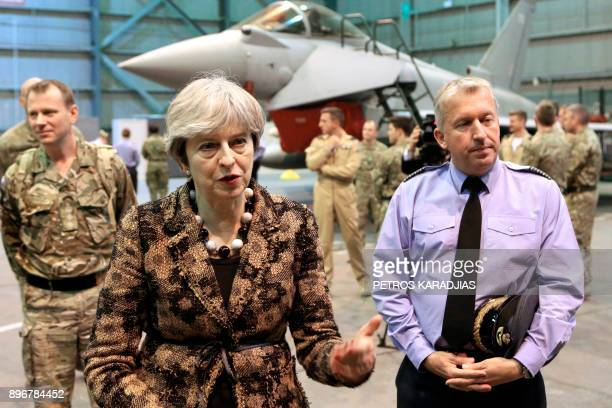 British Prime Minister Theresa May speaks with troops upon her arrival to wish British servicemen happy holidays at the RAF Akrotiri British military...