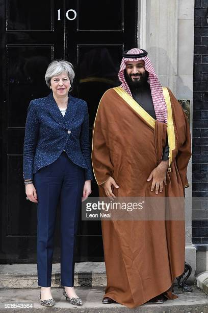 British Prime Minister Theresa May stands next to Saudi Crown Prince Mohammed bin Salman on the steps of number 10 Downing Street on March 7 2018 in...
