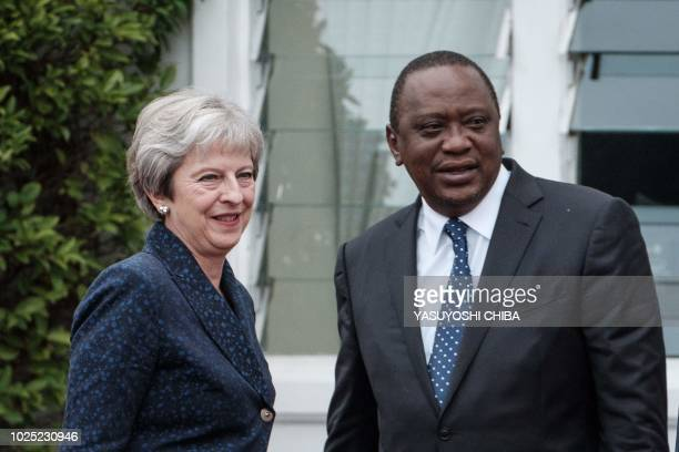 British Prime Minister Theresa May stands with Kenyan President Uhuru Kenyatta at the State House in Nairobi on August 30 2018 May wraps up a three...
