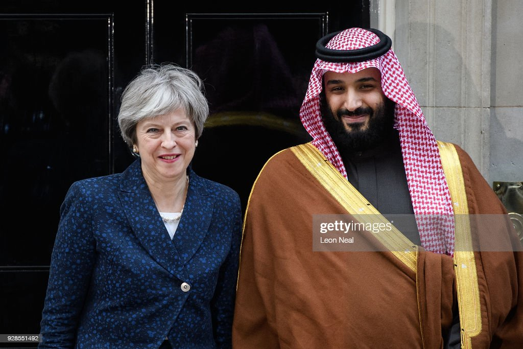 British Prime Minister Theresa May (L) stands with Saudi Crown Prince Mohammed bin Salman on the steps of number 10 Downing Street on March 7, 2018 in London, England. Saudi Crown Prince Mohammed bin Salman has made wide-ranging changes at home supporting a more liberal Islam. Whilst visiting the UK he will meet with several members of the Royal family and the Prime Minister.