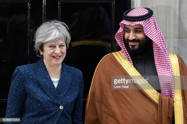 British Prime Minister Theresa May stands with Saudi Crown Prince Mohammed bin Salman on the steps of number 10 Downing Street on March 7 2018 in...