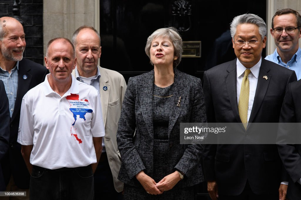 GBR: Theresa May Hosts The Divers Who Rescued The Trapped Thai Boys Football Team