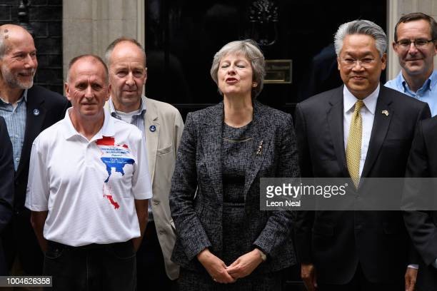 British Prime Minister Theresa May stands with the Thai Ambassador to the UK Pisanu Suvanajata and members of the British cave diving team and their...