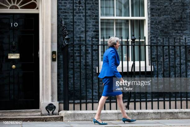 British Prime Minister Theresa May steps out of Number 10 Downing Street to greet Prime Minister of the Czech Republic Andrej Babis on October 24...