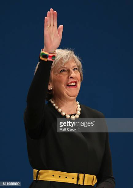 British Prime Minister Theresa May takes to the stage to deliver a speech to about Brexit on the first day of the Conservative Party Conference 2016...
