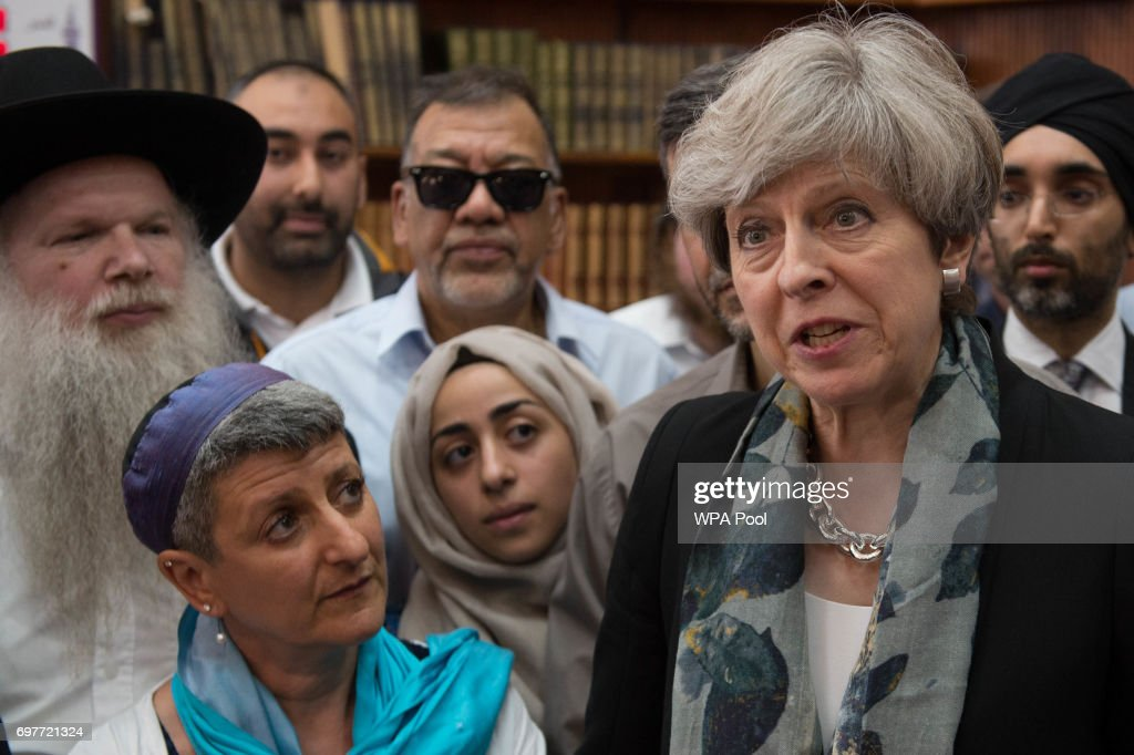 British Prime Minister Theresa May talks to faith leaders at Finsbury Park Mosque on June 19, 2017 in London, England. Worshippers were struck by a hired van as they were leaving Finsbury Park mosque in North London after Ramadan prayers. One person was killed in the terror attack with a further 10 people injured.