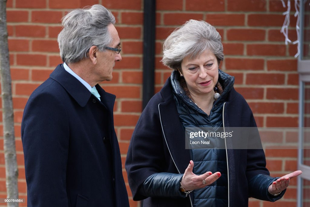 British Prime Minister Theresa May (R) talks with Conservative MP for Wokingham John Redwood during a visit to a new housing development on January 3, 2018 in Wokingham, England. The Government has today claimed that 16,000 first-time buyers have benefited from changes to the stamp duty rules.