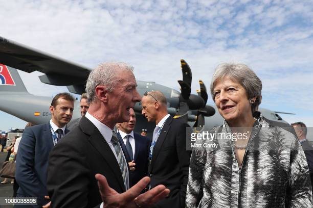 British Prime Minister Theresa May arrives to deliver a speech as she opens the Farnborough Airshow on July 16 2018 in Farnborough England Theresa...