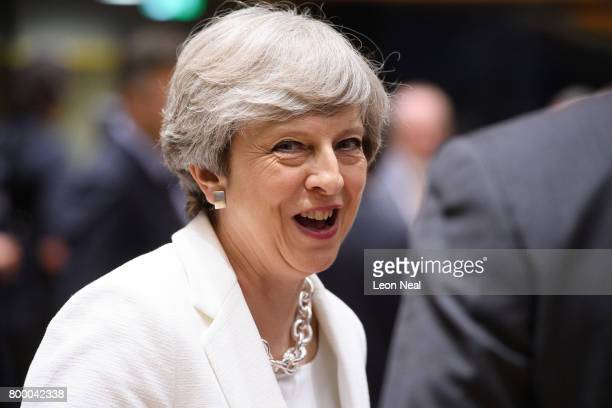 British Prime Minister Theresa May talks with other leaders ahead of a roundtabel meeting at the EU Council headquarters on the second day of a two...