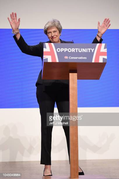 British Prime Minister Theresa May thanks supporters as she delivers her leader's speech during the final day of the Conservative Party Conference at...