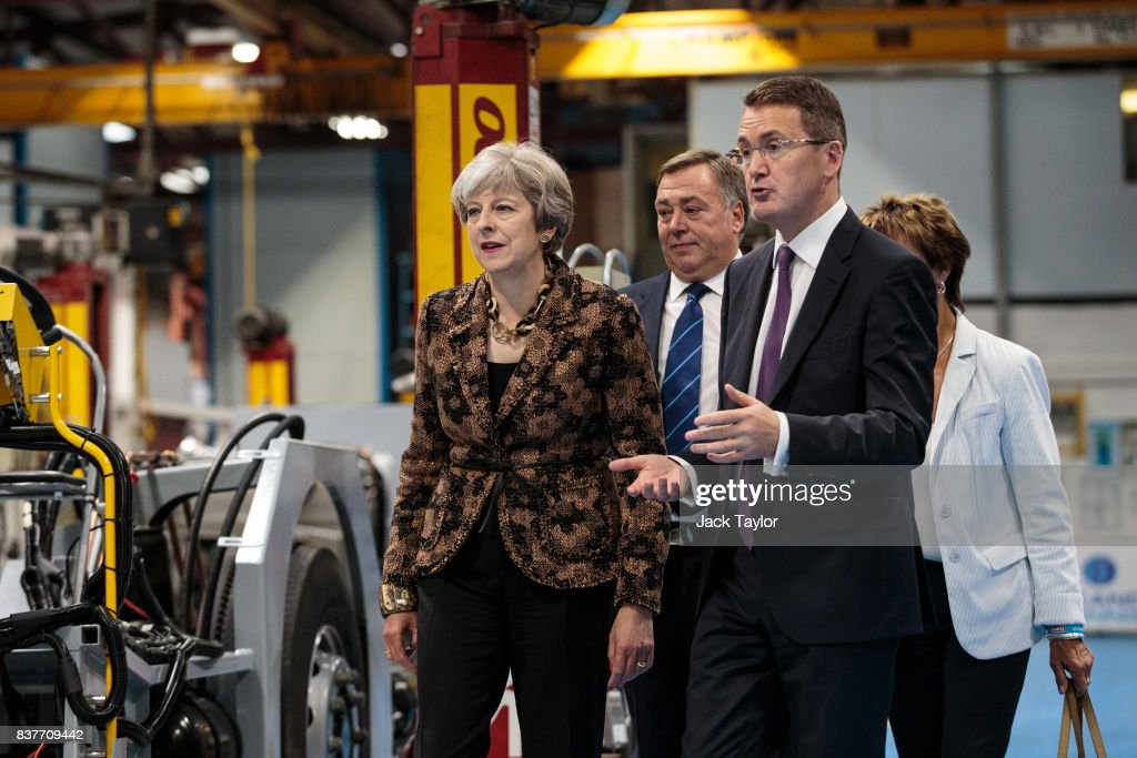 British Prime Minister Theresa May (L) tours the Alexander Dennis bus and coach manufacturers factory on August 23, 2017 in Guildford, England. The company has secured £44m from a £1.7bn government fund to help businesses with exports following Britain's withdrawal from the European Union.
