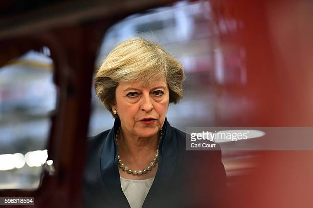 British Prime Minister Theresa May views a car on a production line during a visit to the Jaguar Land Rover factory on September 1 2016 in Solihull...