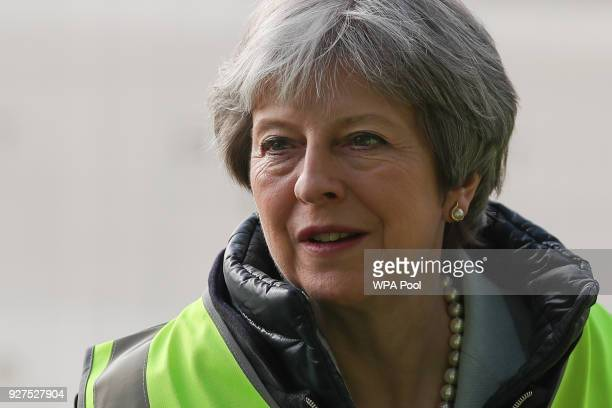 British Prime Minister Theresa May visits a housing development on March 5 2018 in East London England