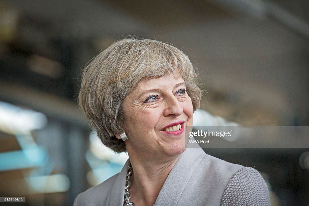 British Prime Minister Theresa May visits Martinek joinery factory on August 3, 2016 in London, United Kingdom.