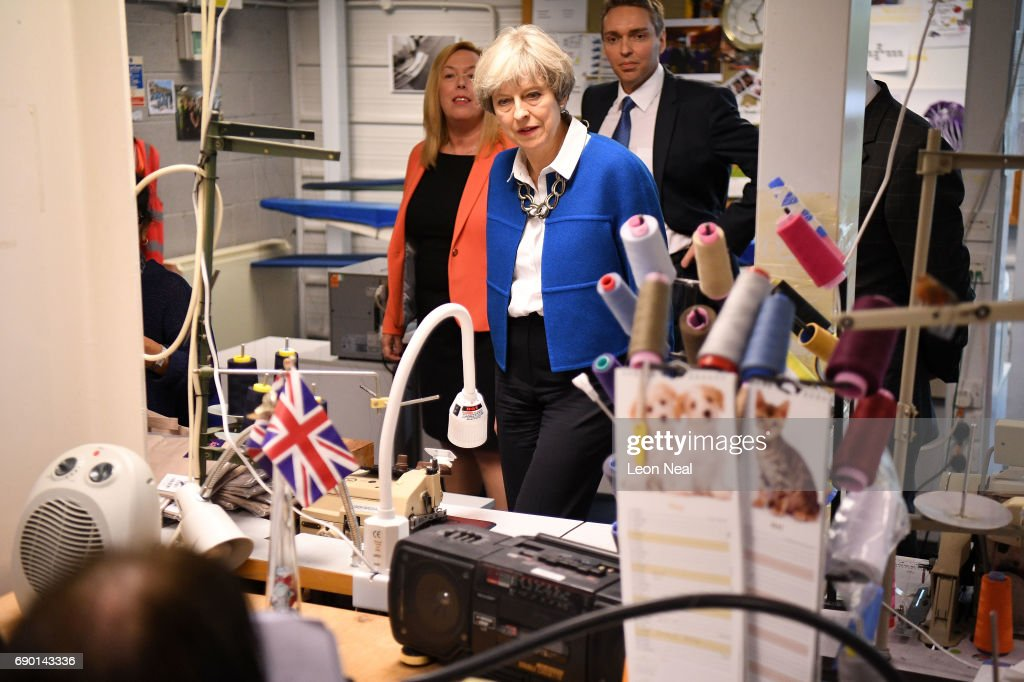 British Prime Minister, Theresa May visits Simon Jersey, a business uniform supplier in the Constituency of Hyndburn on May 30, 2017 in Accrington, England. Britain goes to the polls on June 8 to elect a new parliament in a general election.