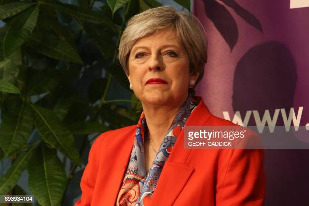 British Prime Minister Theresa May waits for the results to be declared at the count centre in Maidenhead early in the morning of June 9 hours after...