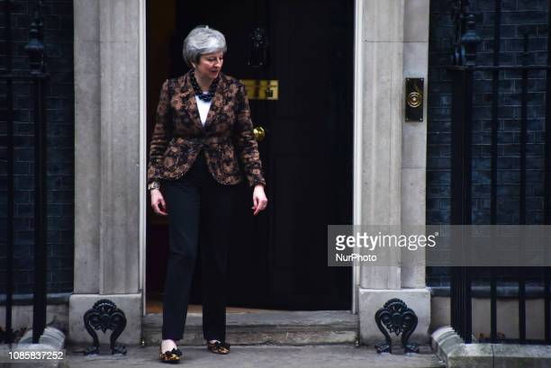 British Prime Minister Theresa May walks away from the door of 10 Downing Street to greet New Zealand's Prime Minister Jacinda Ardern in central...