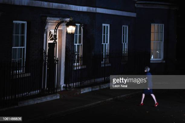British Prime minister Theresa May walks back to Number 10 after delivering a Brexit statement at Downing Street on November 14 2018 in London...