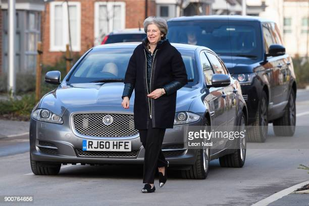 British Prime Minister Theresa May walks from her car during a visit to a new housing development on January 3 2018 in Wokingham England The...