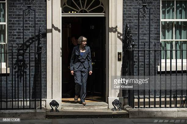 British Prime Minister Theresa May walks out of 10 Downing Street to greet the Irish Taoiseach Enda Kerry on July 26 2016 in London England Theresa...
