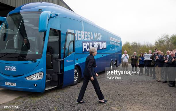 British Prime Minister Theresa May walks past the Conservative party's general election campaign 'battle bus' to thanks supporters after making a...